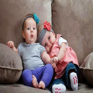 small_happy-lovely-little-baby-couple