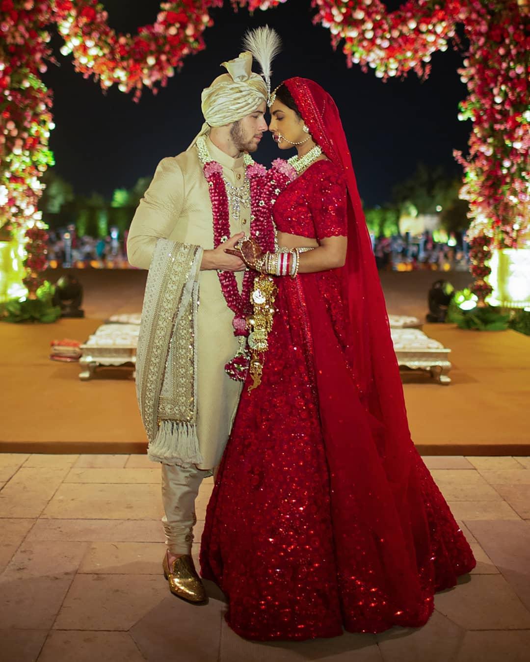 Nickyanka christain ceremony hindu ceremony Ralph Lauren bride groom season Priyanka Chopra Nick Jonas wedding marriage jodhour bollywood Hollywood gown designer party guest wedding dress royal wedding